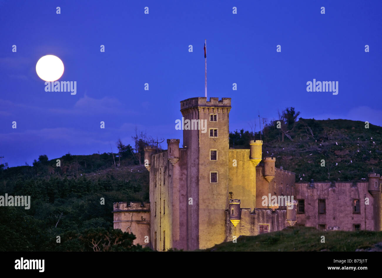 Dunvegan Castle highlands Isle of Skye scotland old building landmark historical moonlight old building architecture - Stock Image
