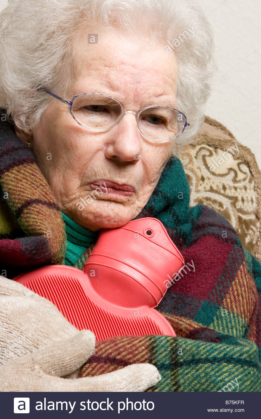 an old woman holding a hot water bottle stock photo: 21638059 - alamy