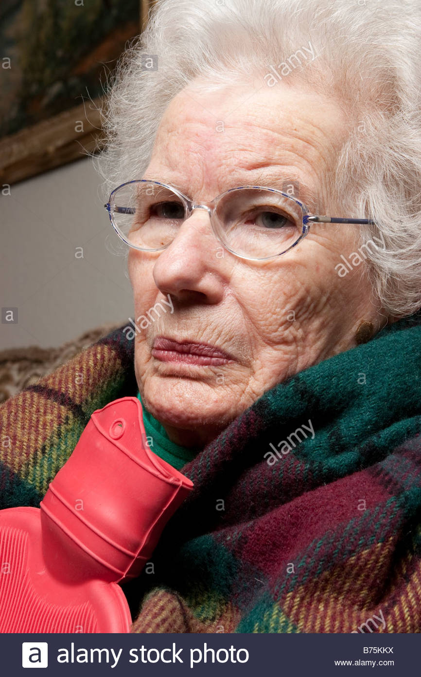 an old woman holding a hot water bottle stock photo: 21638174 - alamy