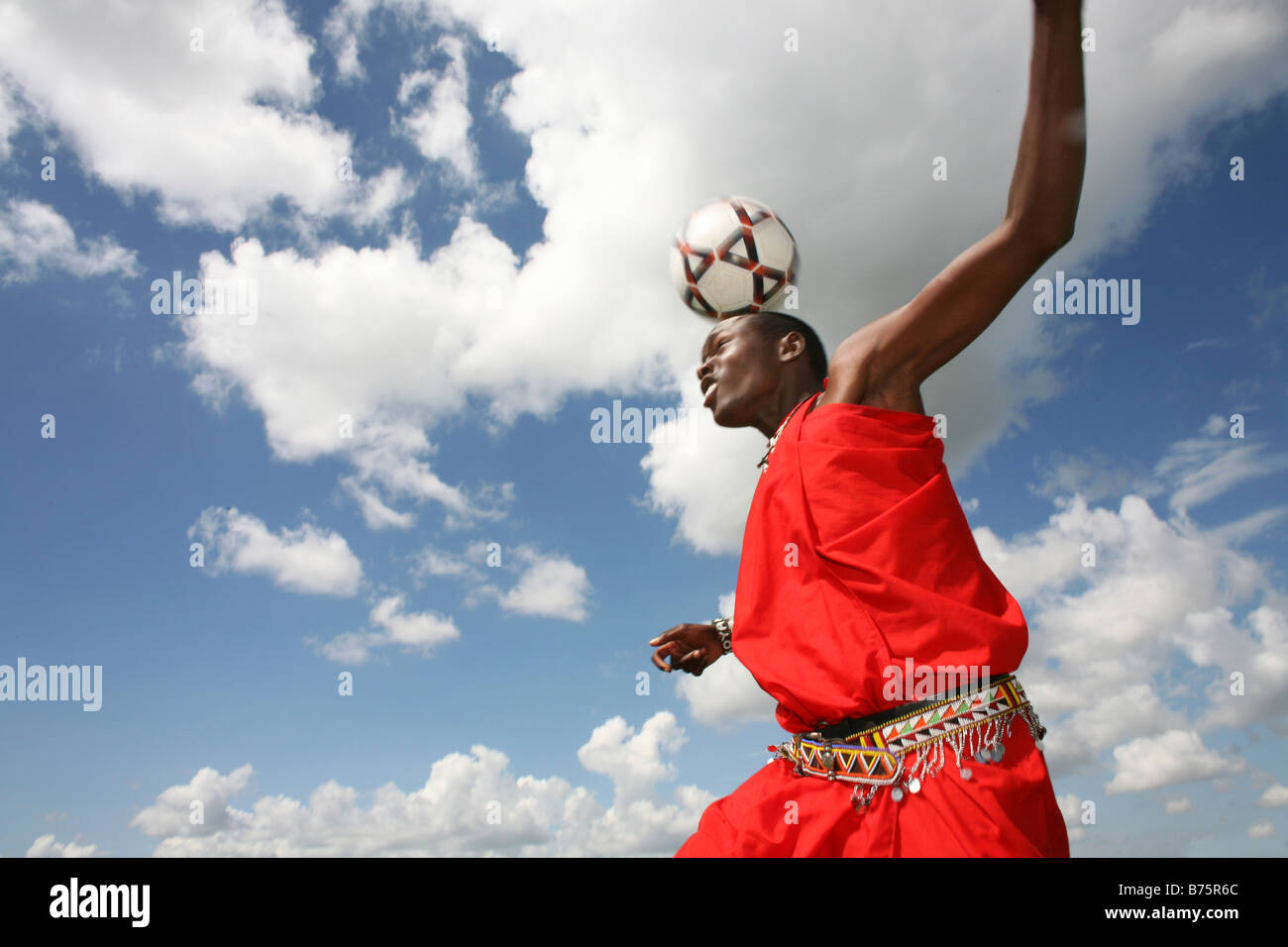 Football is opne of the most popular activities among the Massai tribe in south kenya Whenever their cows are brought - Stock Image