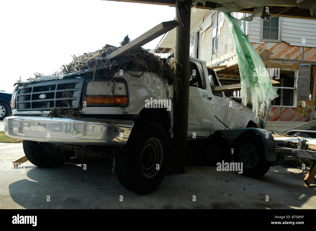 barely recognisable SUV after being wrecked in Hurricane katrina - Stock Image