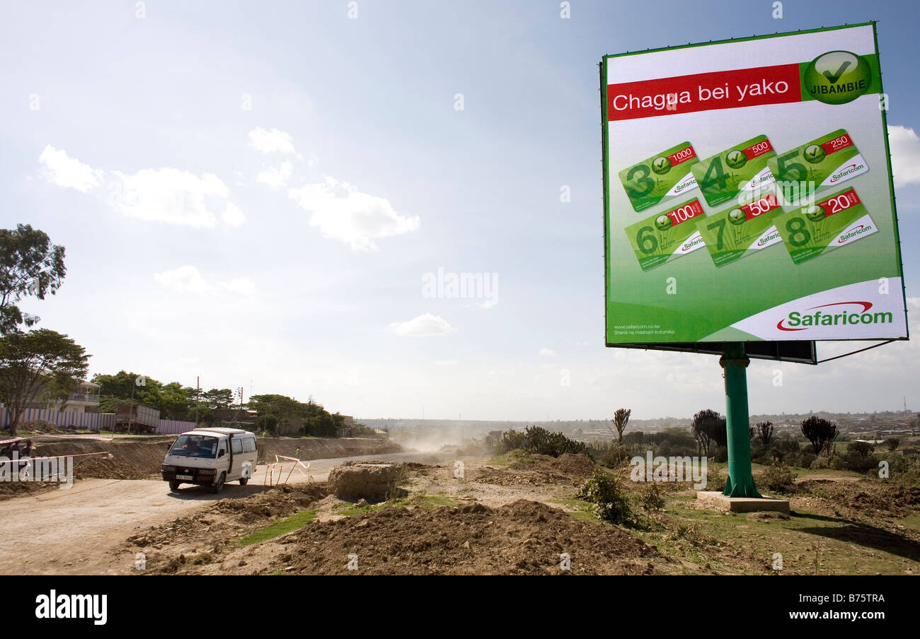 Commercial billboards are increasing in kenya as the economy is getting stronger Safaricom is a telecom provider Stock Photo