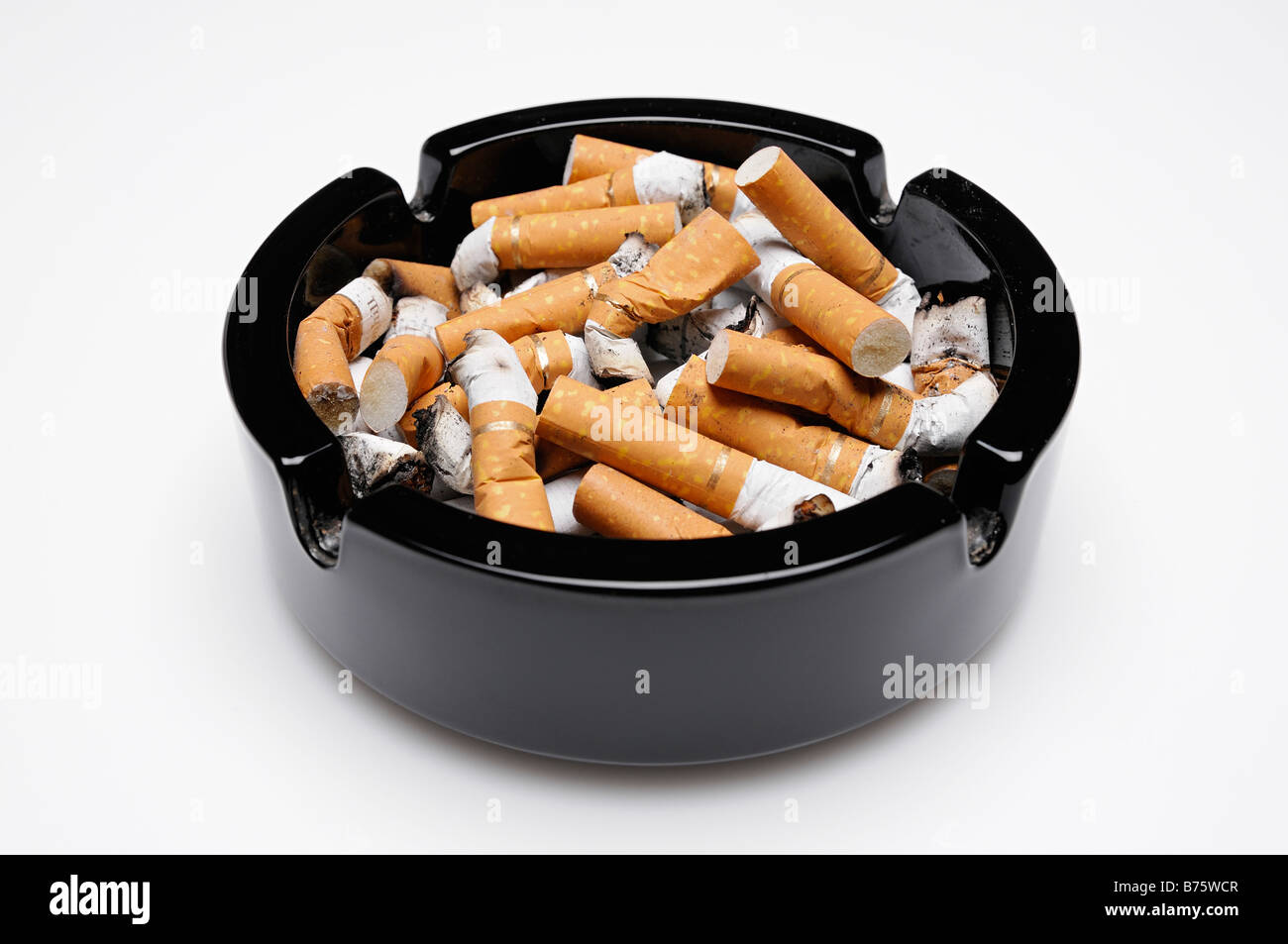 Ashtray Full of Cigarette Ends Close Up - Stock Image