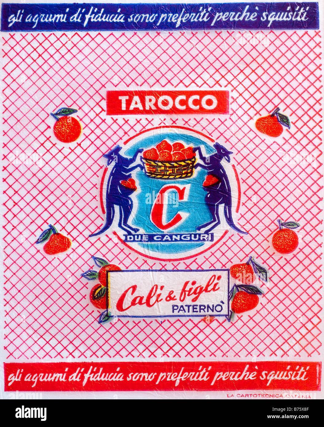 Printed ephemera / Citrus fruit wrapper from Italy - Kangaroos holding basket illustration on tissue paper. - Stock Image