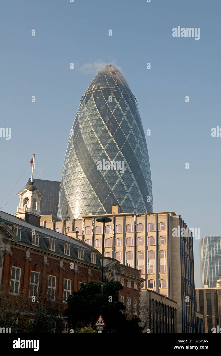 30 St Mary Axe, also known as the Swiss Re Tower or 'The Gherkin', is a skyscraper in London's main - Stock Image
