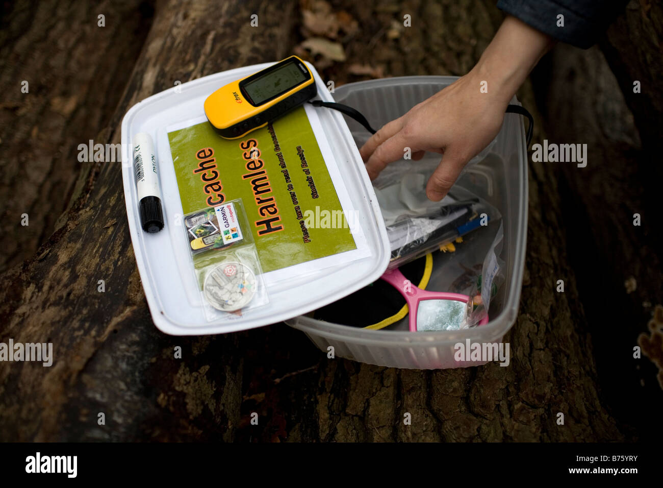 Geocache treasure box found in the countryside - Stock Image