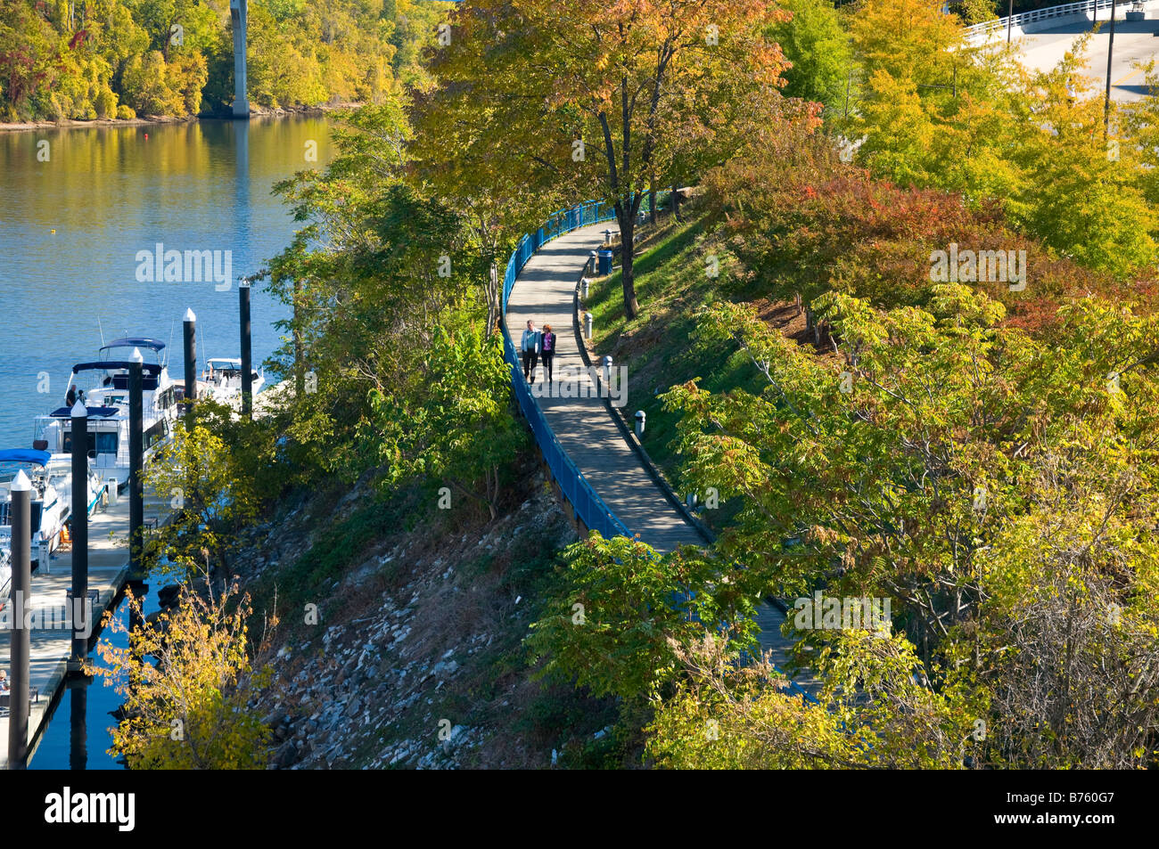 People walking along the Riverwalk beside the Tennessee River in Chattanooga Tennessee - Stock Image