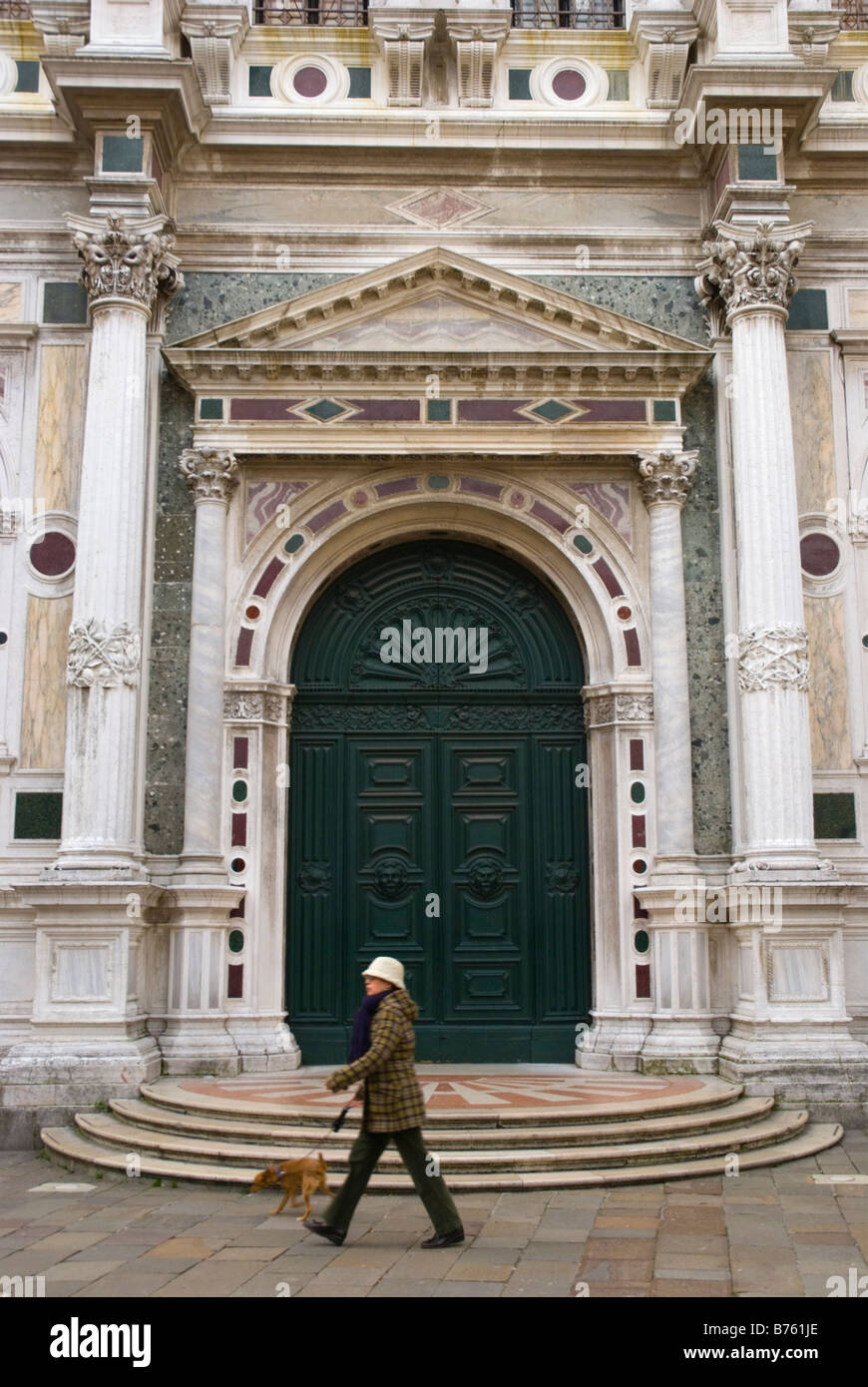 Woman walking a dog at Campo San Rocco in Venice Italy Europe - Stock Image