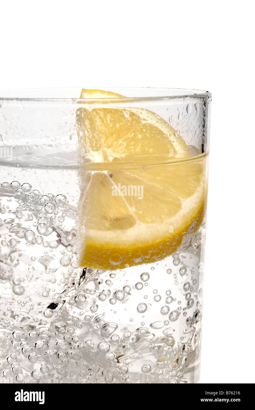 gin, vodka and tonic with lemon slice - Stock Image