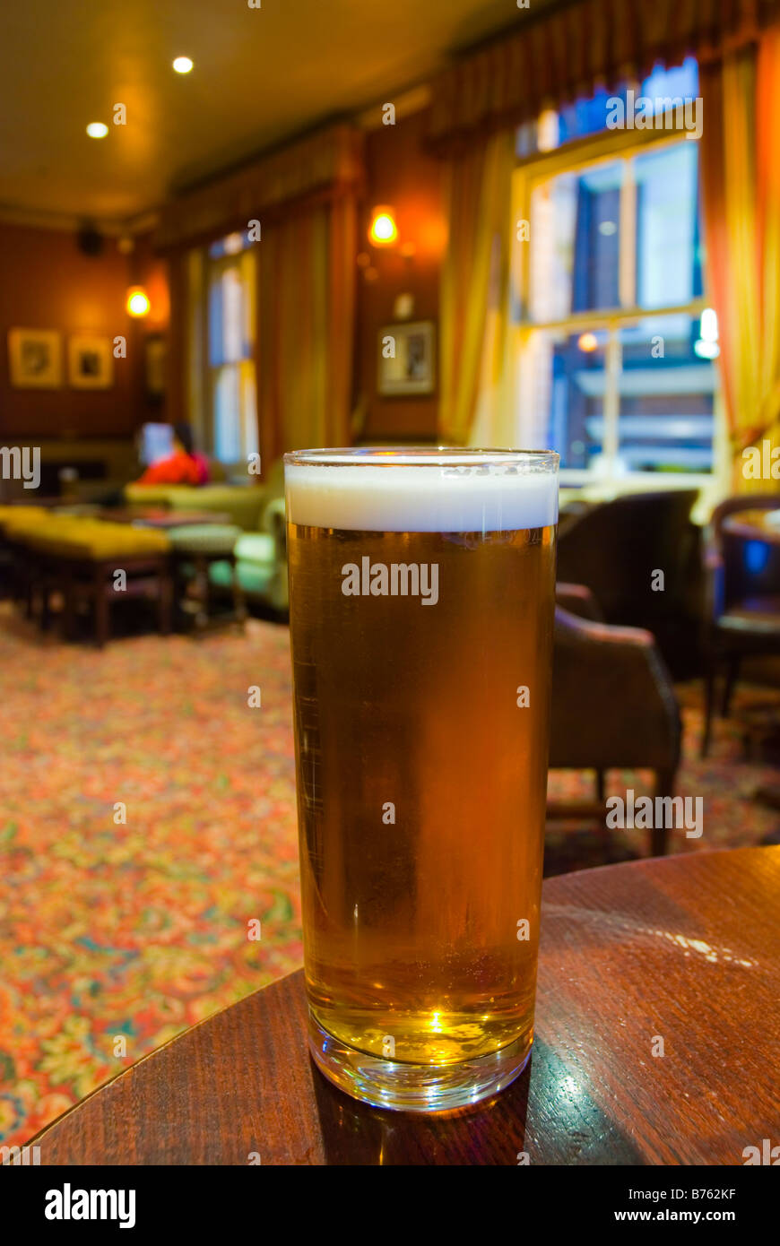Pint of bitter in White Horse pub in Soho in central London England UK - Stock Image