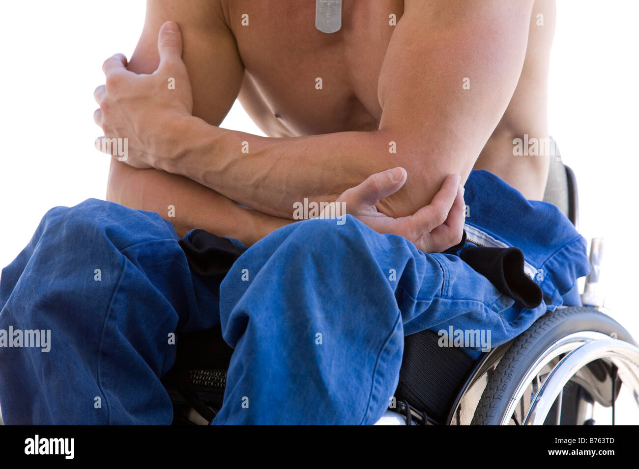Shirtless man on wheelchairs, mid section - Stock Image