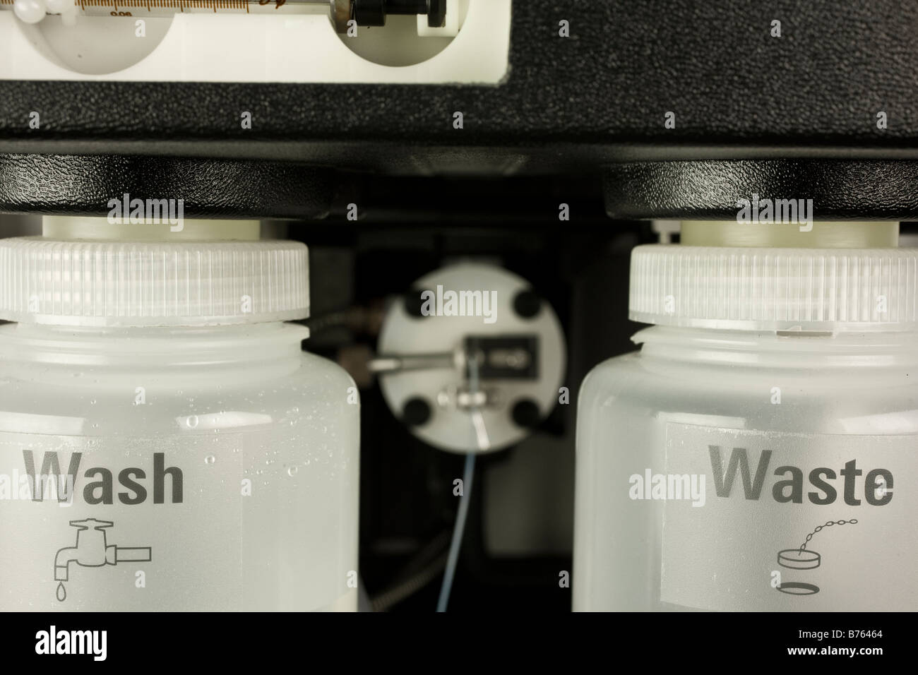 Wash and waste collection vessels for atomic absorption autosampler, Stock Photo