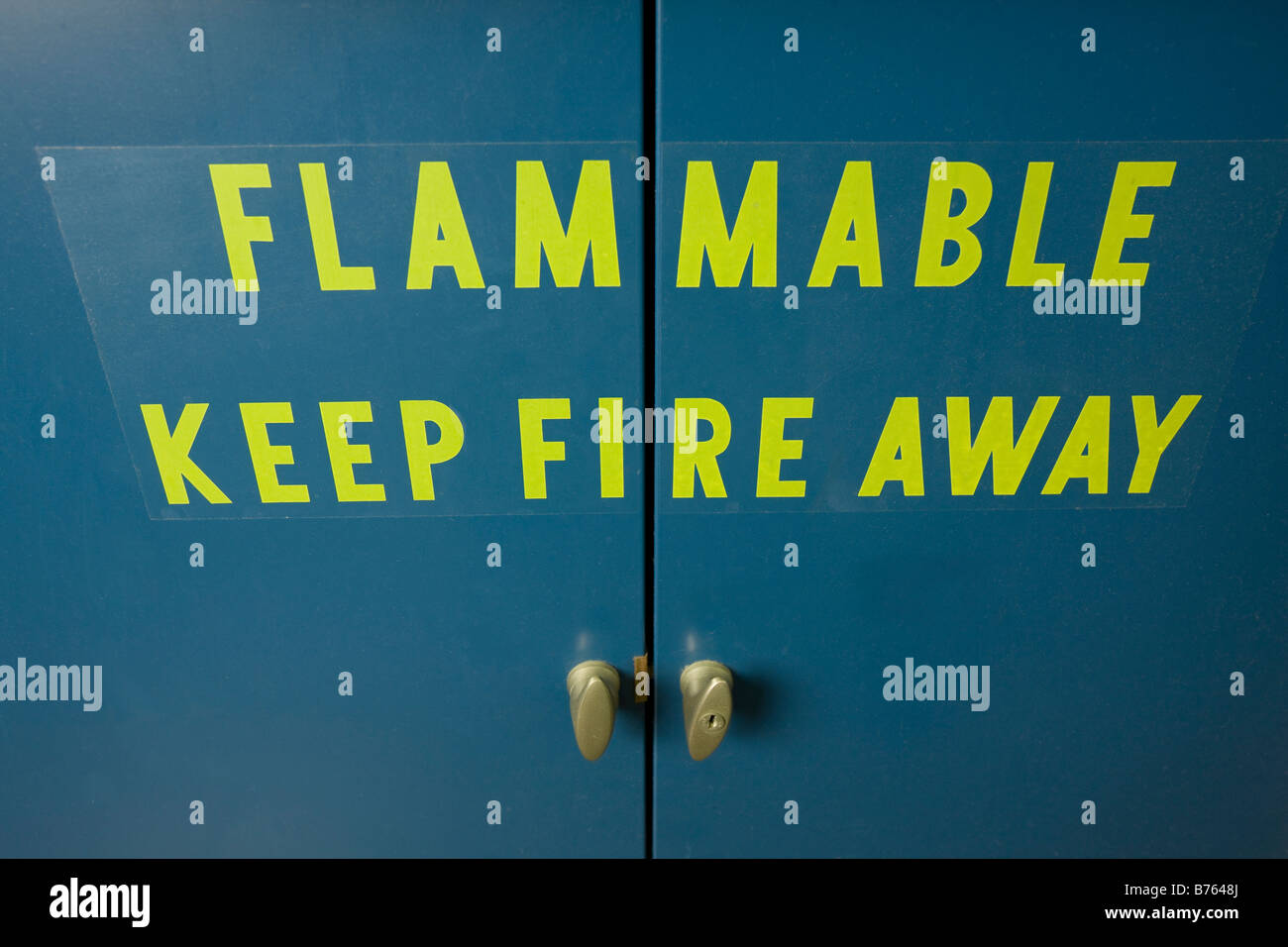 Weaning on ventilated flammable cabinet door - Stock Image