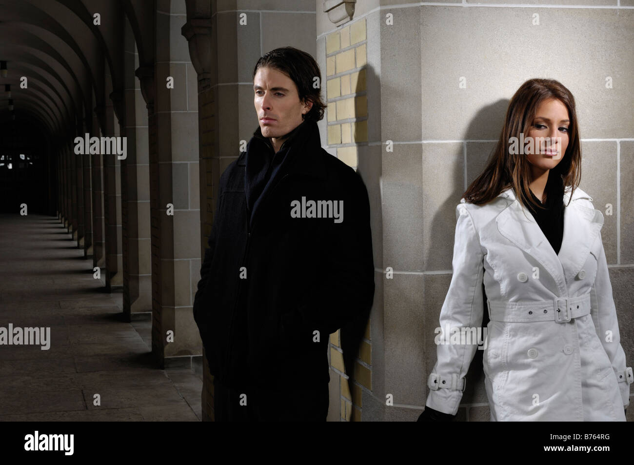 Young man and woman standing apart - Stock Image