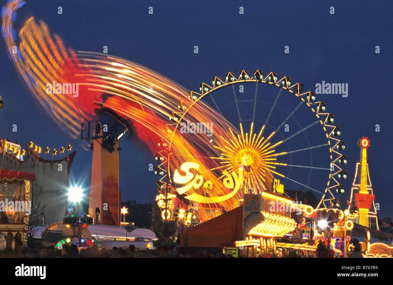 october festival big wheel fairground ride munich folk festival bavaria germany sight fun thrill Stock Photo