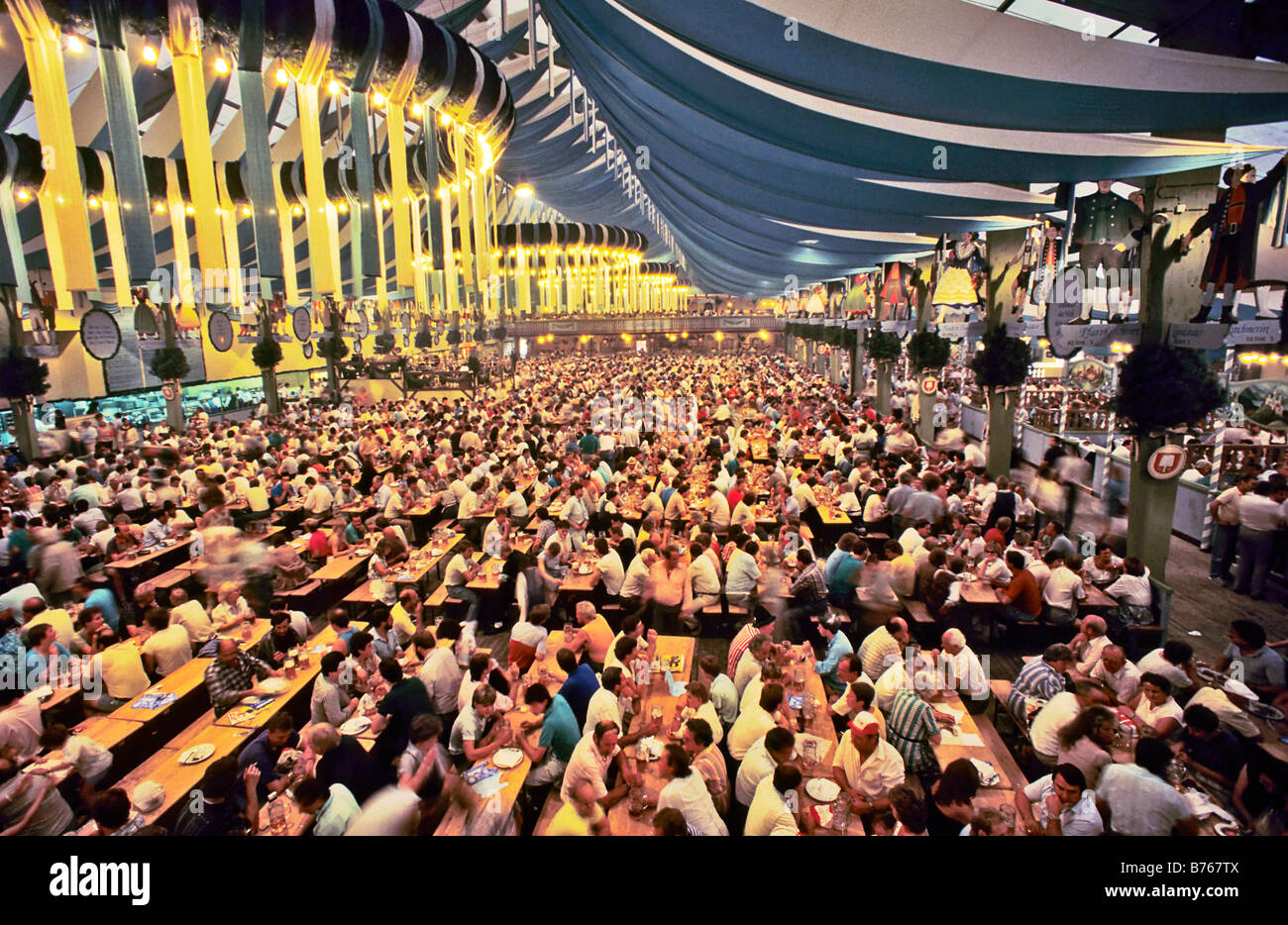 munich beer festival beer tent october festival waitress bavaria germany europe people party drinking Stock Photo