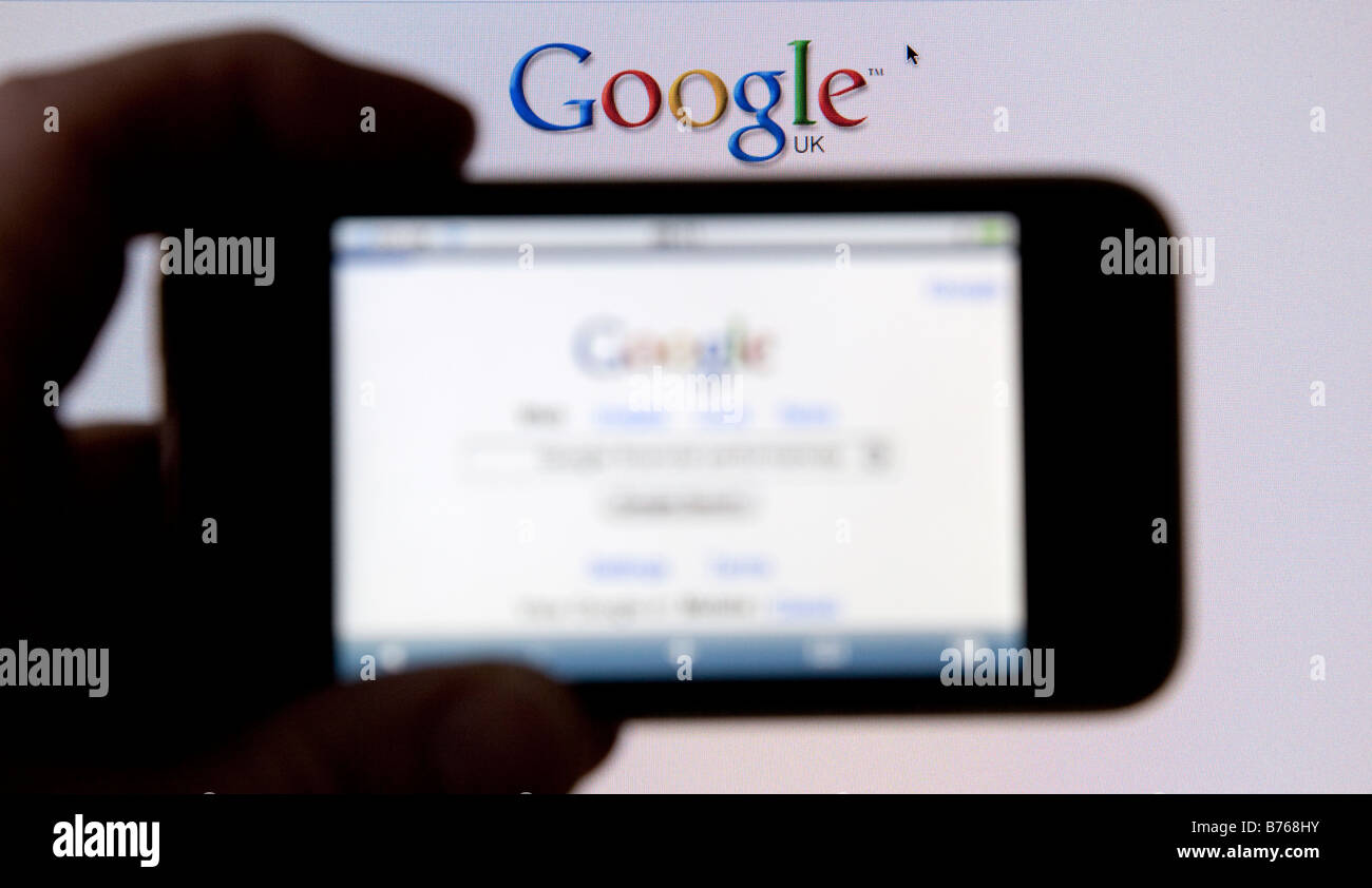 Internet giant Google Inc logo on the screen of an iPhone - Stock Image
