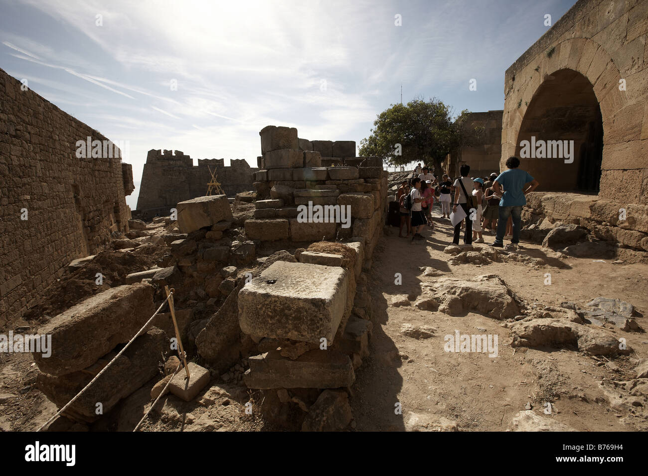 School children looking around the ruins of the Acropolis Lindos Island of Rhodes Greece - Stock Image