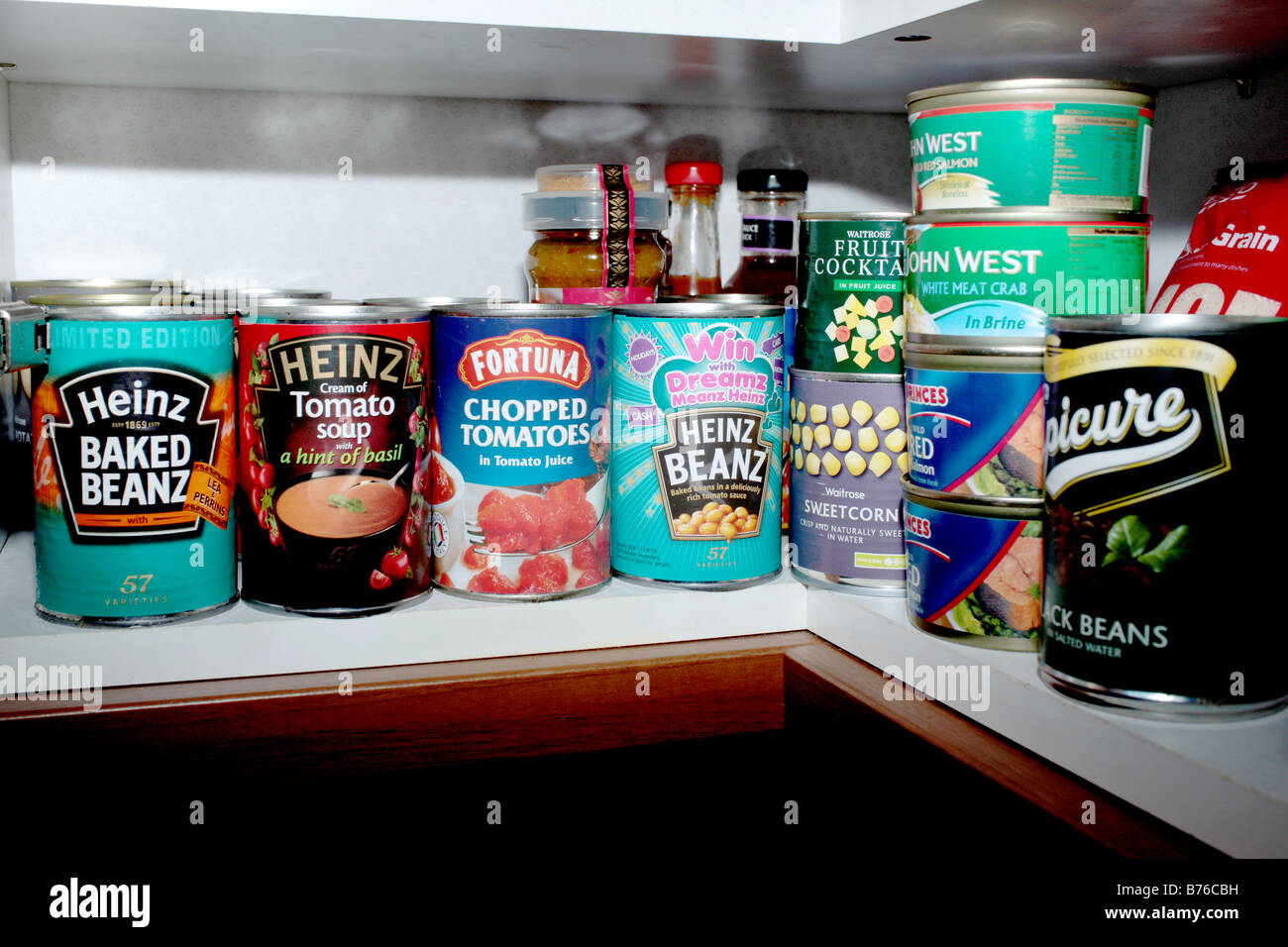 Cupboard of Tinned Food - Stock Image