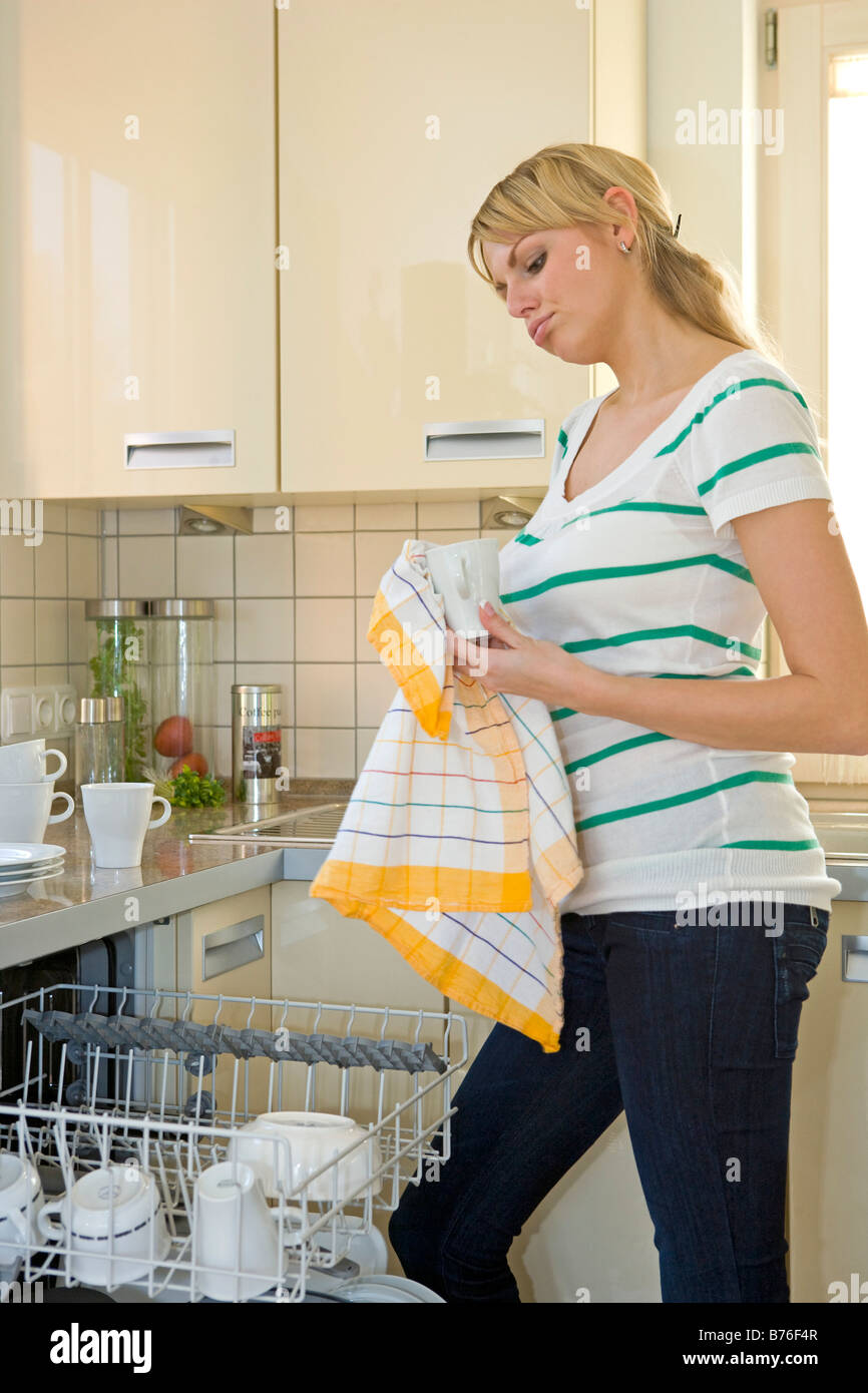Frau bei der Hausarbeit, Woman with the housework Stock Photo