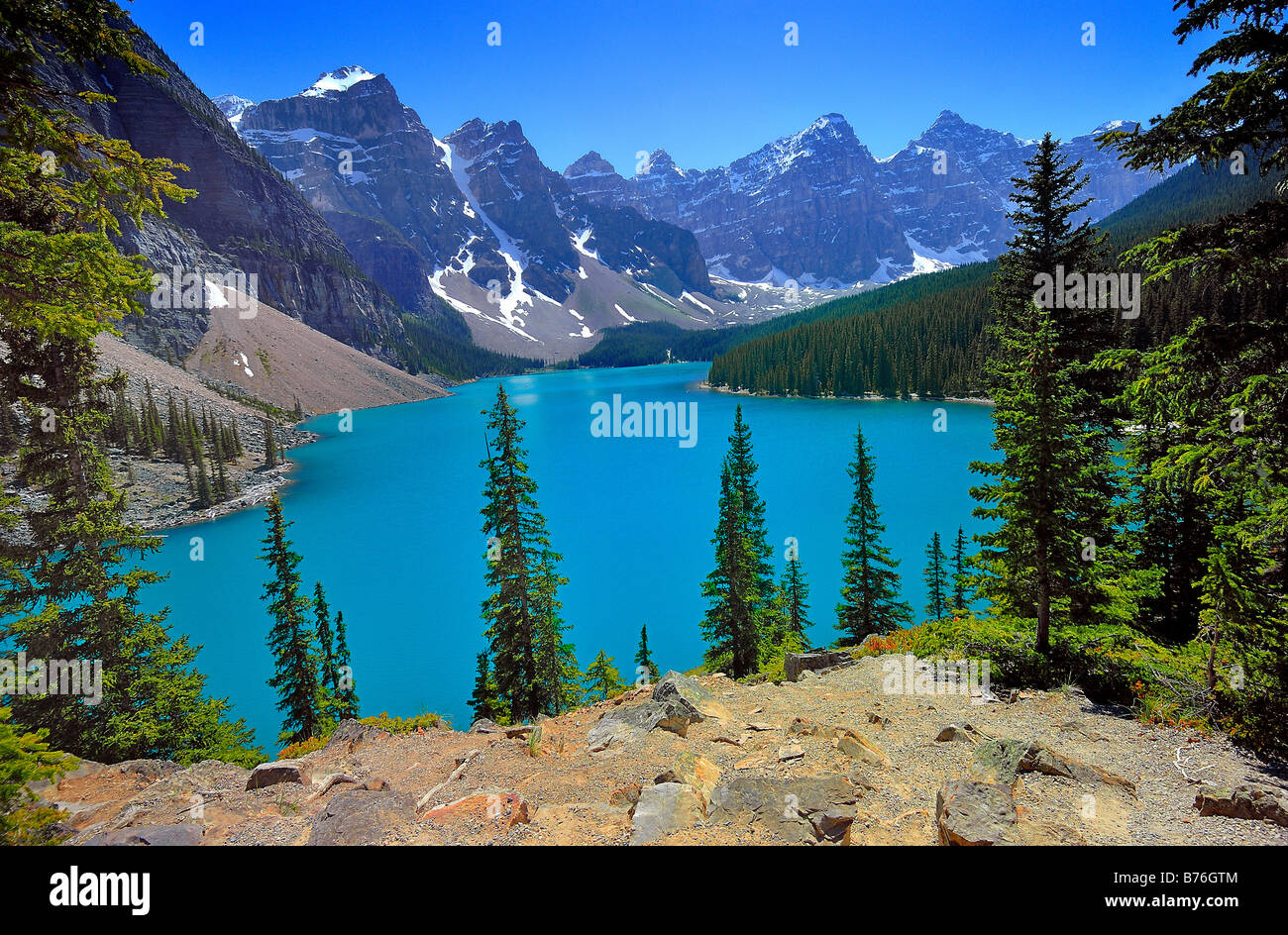 General view of Moraine Lake surrounded by mountain peaks in Banff National Park, Alberta, Canada. Horizontal Format - Stock Image