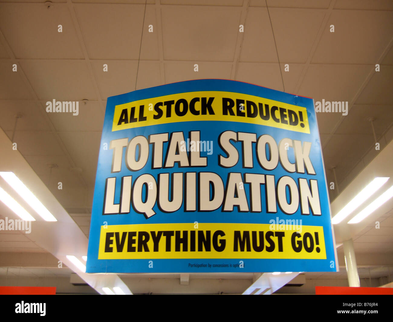 TOTAL STOCK LIQUIDATION - signs in a store closing sale due to Liquidation. (Woolworths) - Stock Image