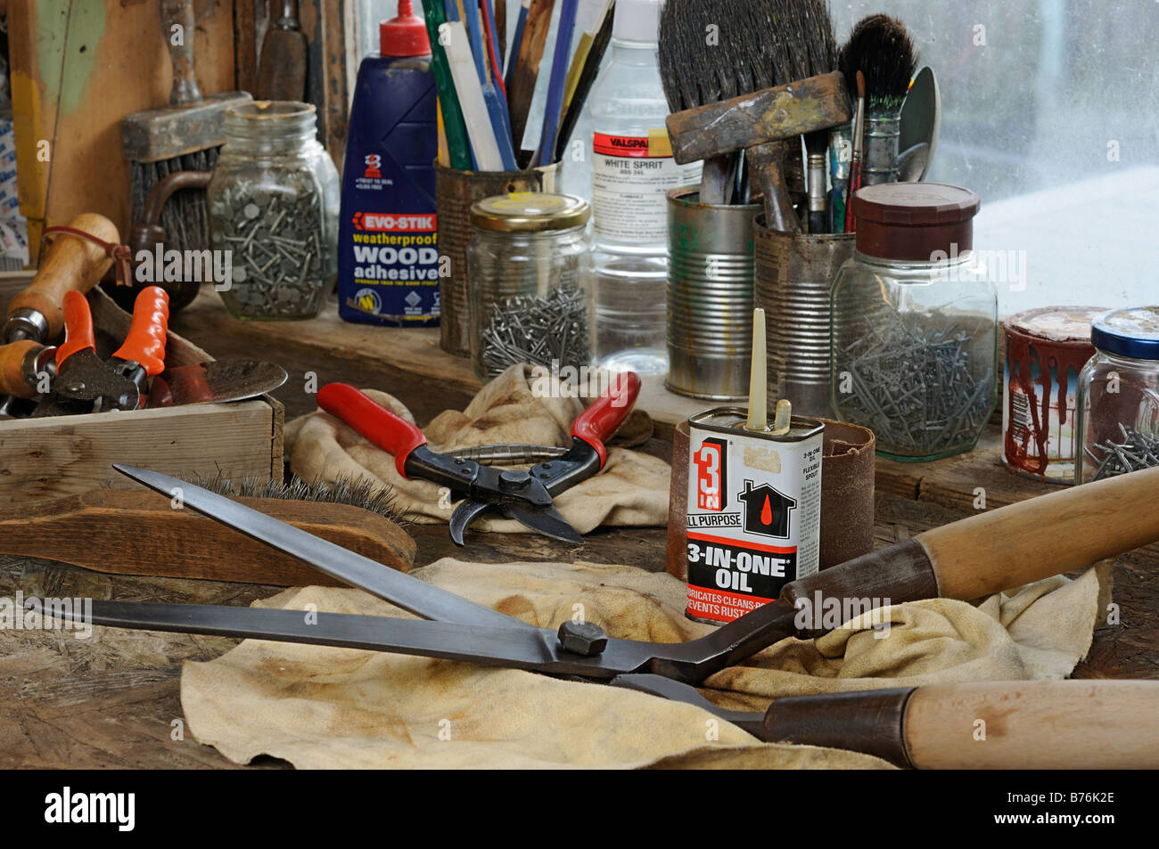 Garden tools secateurs shears on workshop bench ready to be cleaned and sharpened UK December - Stock Image
