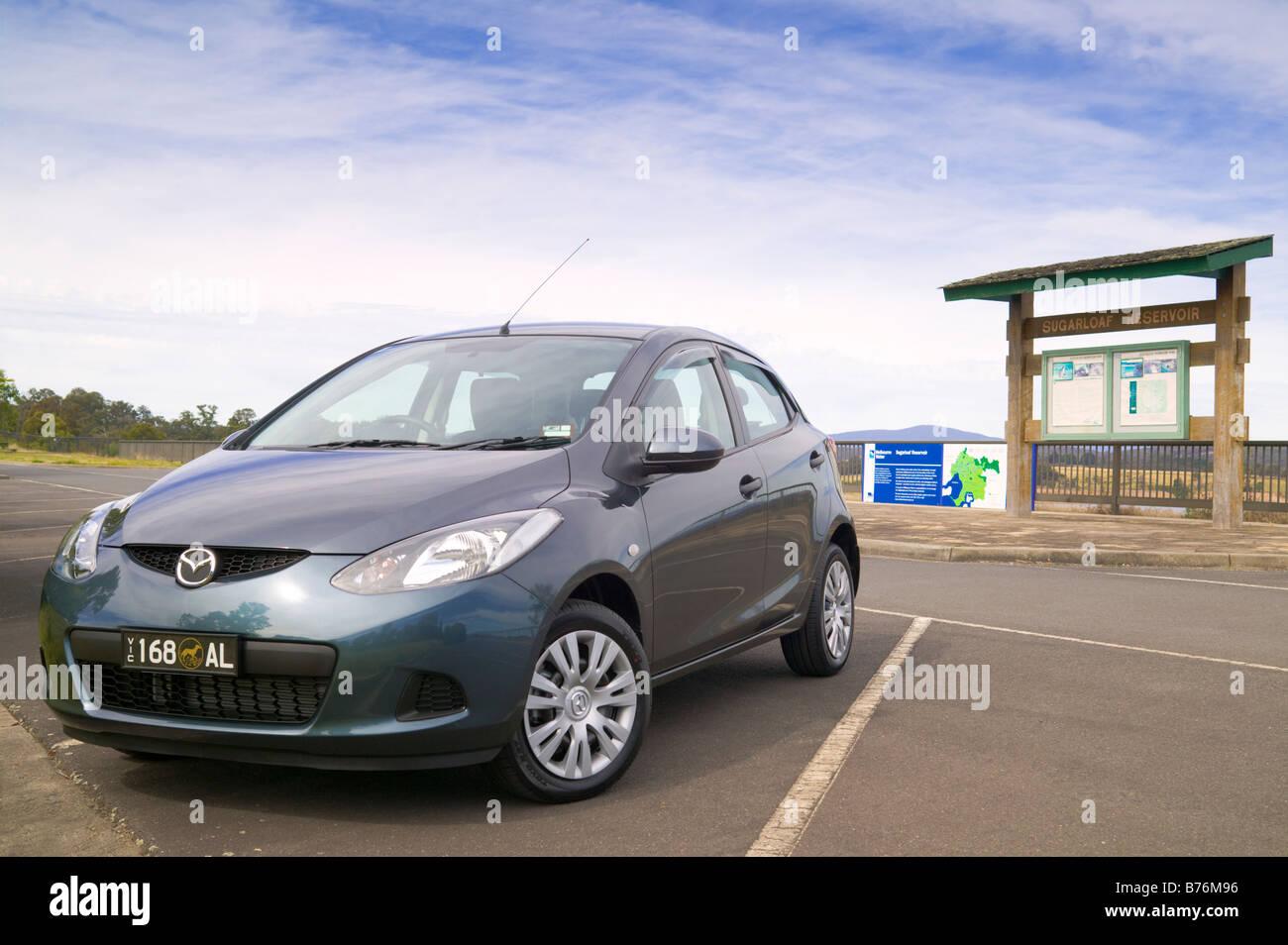Mazda 2 parked in a lot at Sugarloaf Reservoir Park, Melbourne, Australia. - Stock Image
