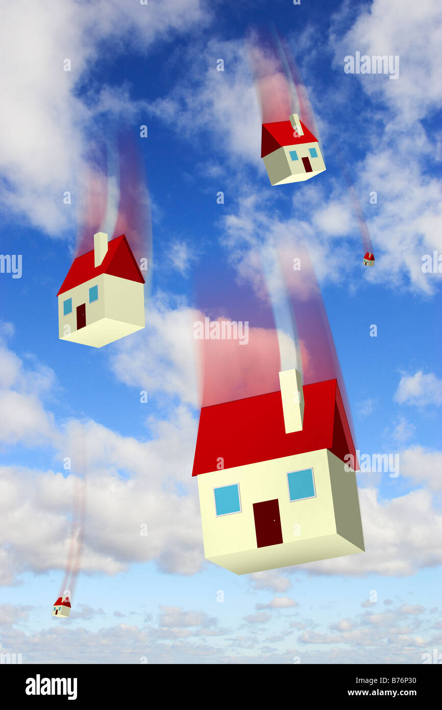 Falling houses against a blue sky representing housing market values and repossession - digital composite - Stock Image