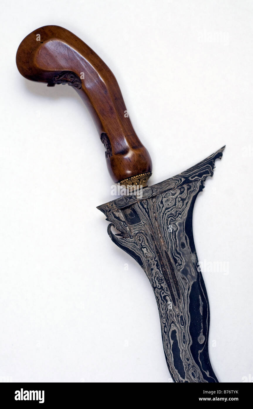 Detail of the hilt and blade of a fine Indonesian kris - Stock Image