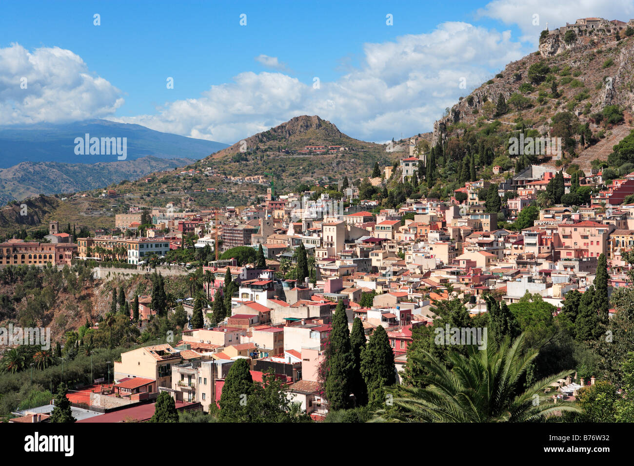 Overview of Taormina with Mount Etna streaming cloud, Sicily - Stock Image