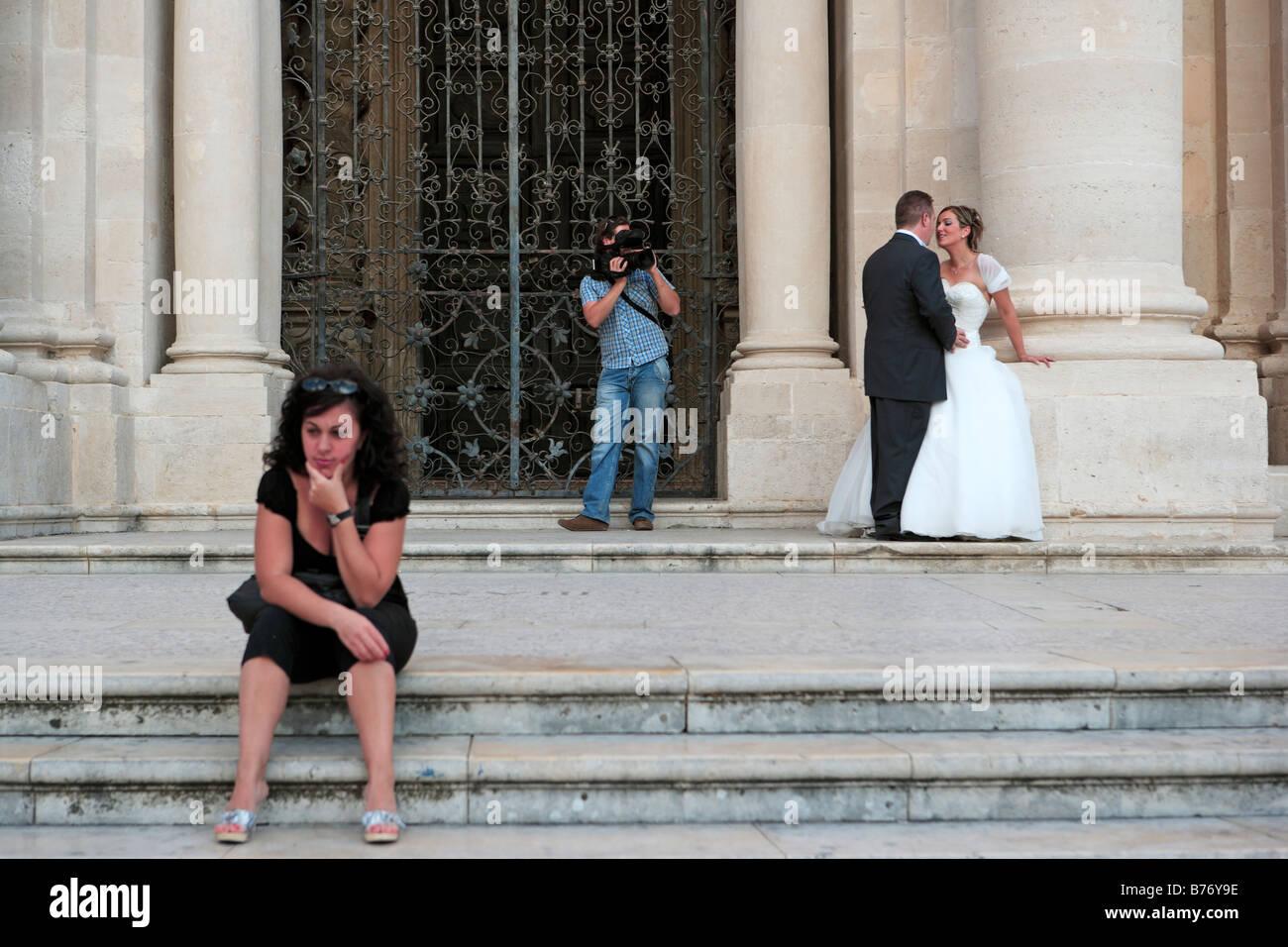 Sicilian Bride and Bridegroom, Syracuse Cathedral, Ortygia, Sicily - Stock Image