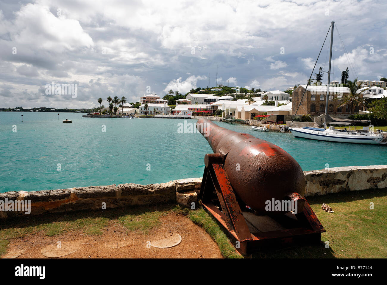 View of a Harbor with an Old Cannon in the Foreground St George Bermuda - Stock Image