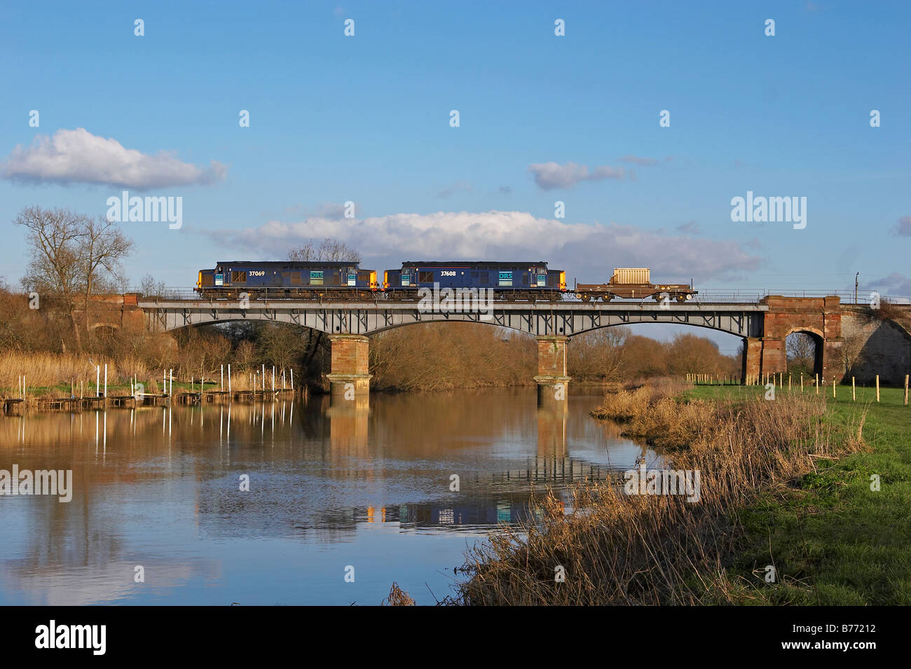 DRS Nuclear Waste train passes over the river Avon in Worcestershire. - Stock Image
