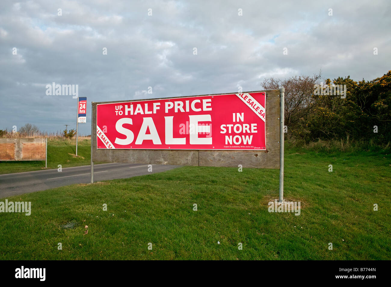A Half Price Sale Sign Outside A Tesco Store In Redruth,cornwall,uk