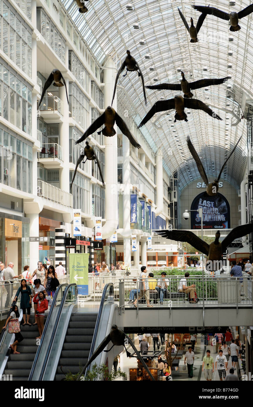 Michael Snow's Geese fly overhead at Toronto's Eaton Centre - Stock Image