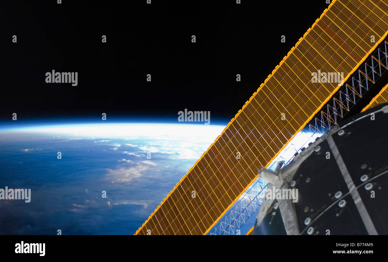 Solar array panels on the International Space Station backdropped against Earth's horizon - Stock Image