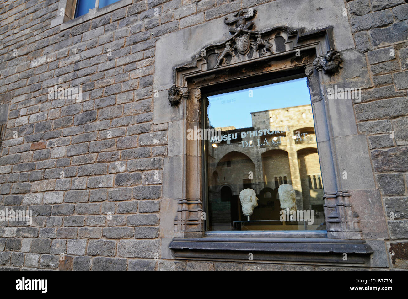 Reflection in a window, Museu de Historia de la Ciutat, historical museum, Placa del Rei, Plaza, Barri Gotic, Barcelona, - Stock Image