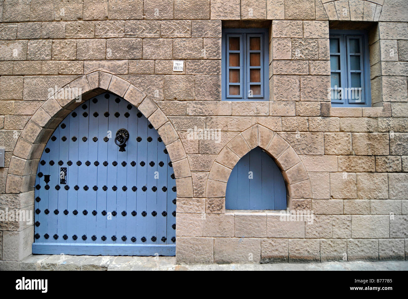 Blue door and windows on a facade, Poble Espanyol, Spanish village, open air museum, Montjuic, Barcelona, Catalonia, - Stock Image