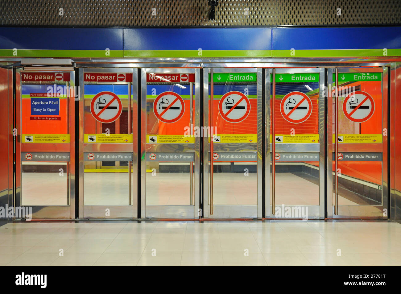 Glass doors, non-smoking signs, deserted, Metrostation El Capricho, Madrid, Spain, Europe - Stock Image