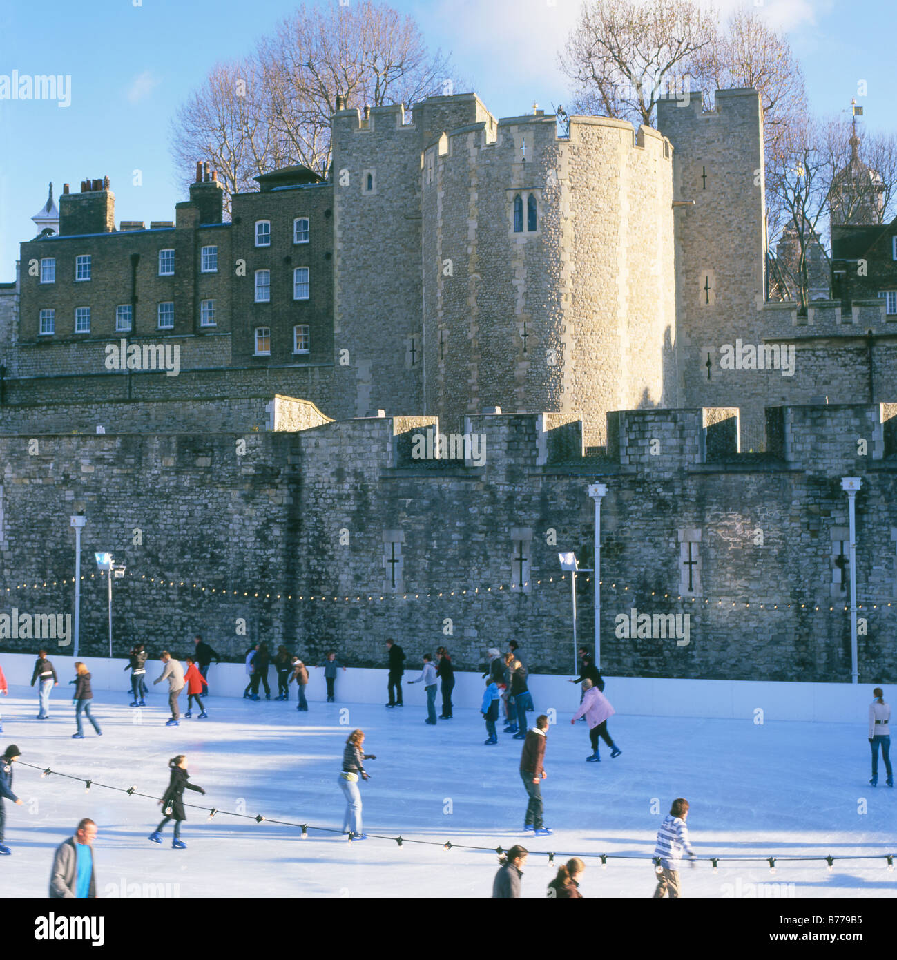 Ice skating at Tower Bridge ice rink London England UK  KATHY DEWITT - Stock Image