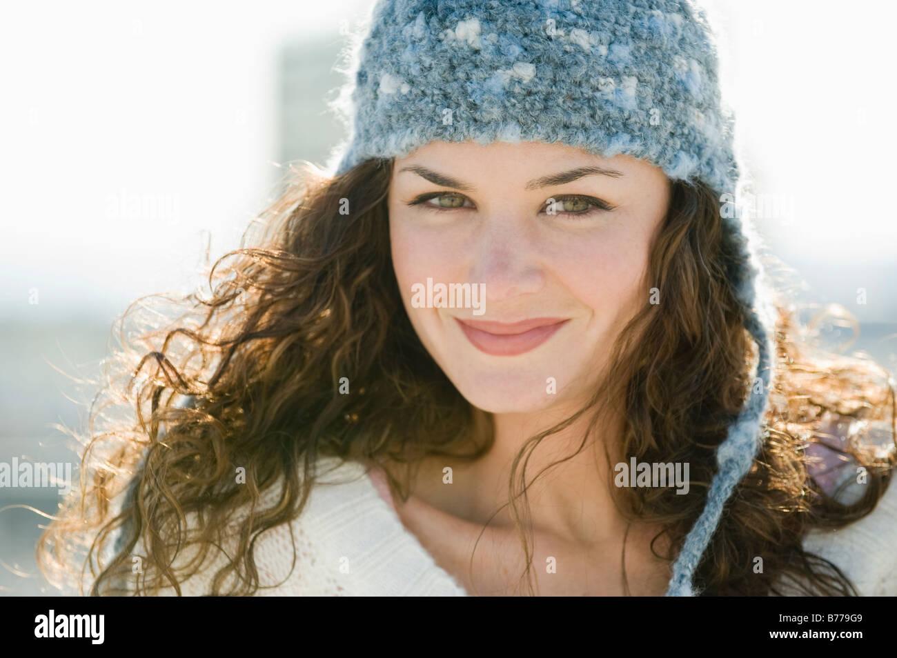Portrait of smiling woman stocking cap - Stock Image