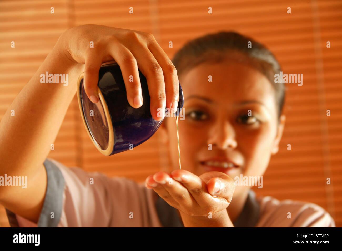 Masseuse, jug, massage oil, Oberoi Luxury Hotel, Mauritius, Indian Ocean Stock Photo