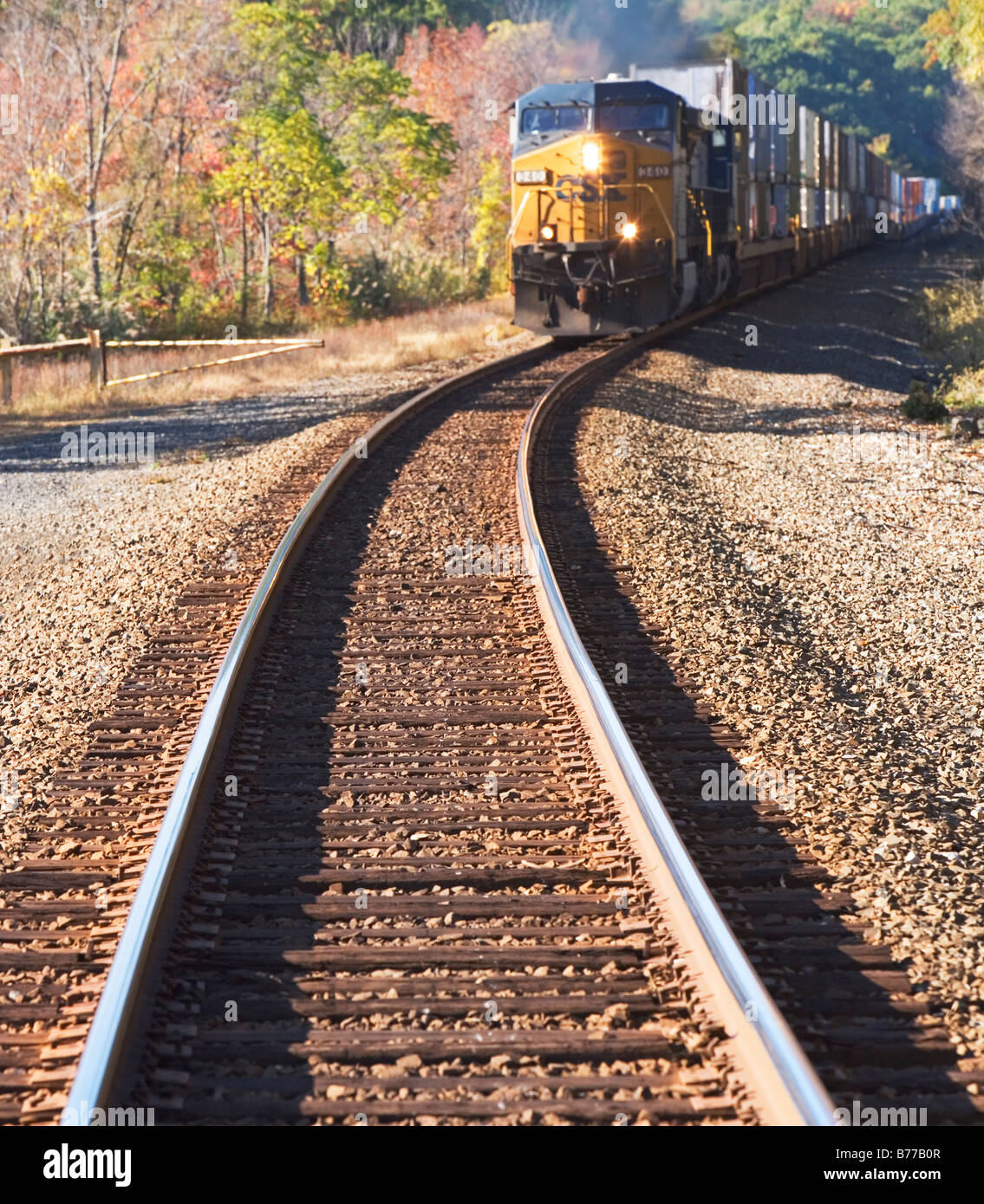 Freight train moving down tracks - Stock Image