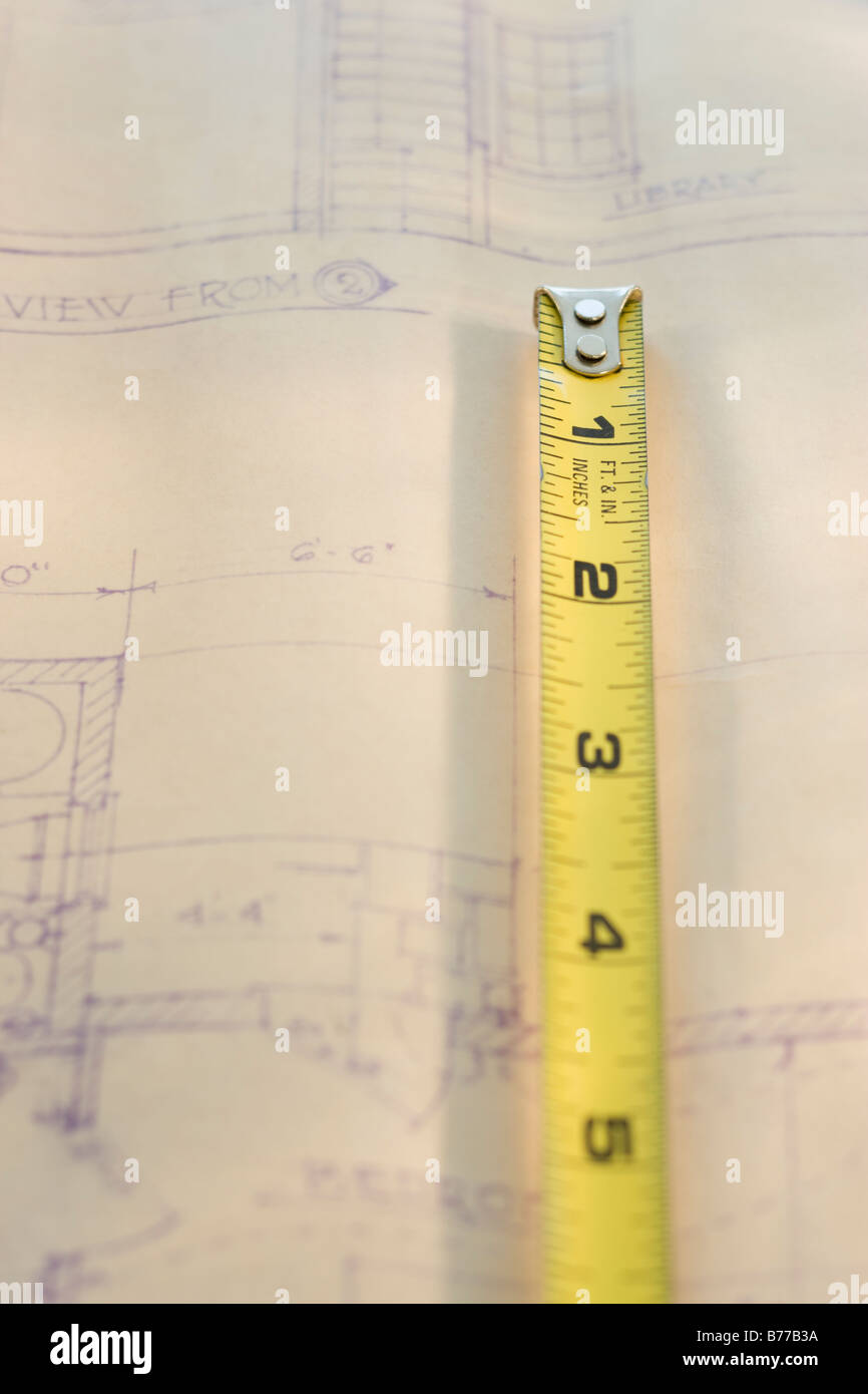 Tape measure on blueprint - Stock Image