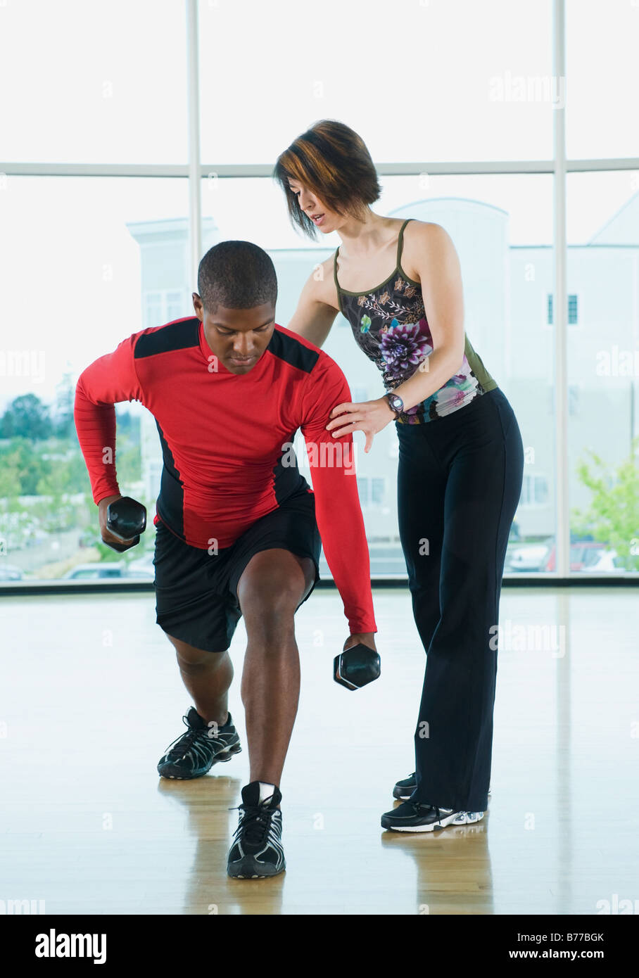 Lunge Dumbbells Stock Photos & Lunge Dumbbells Stock Images