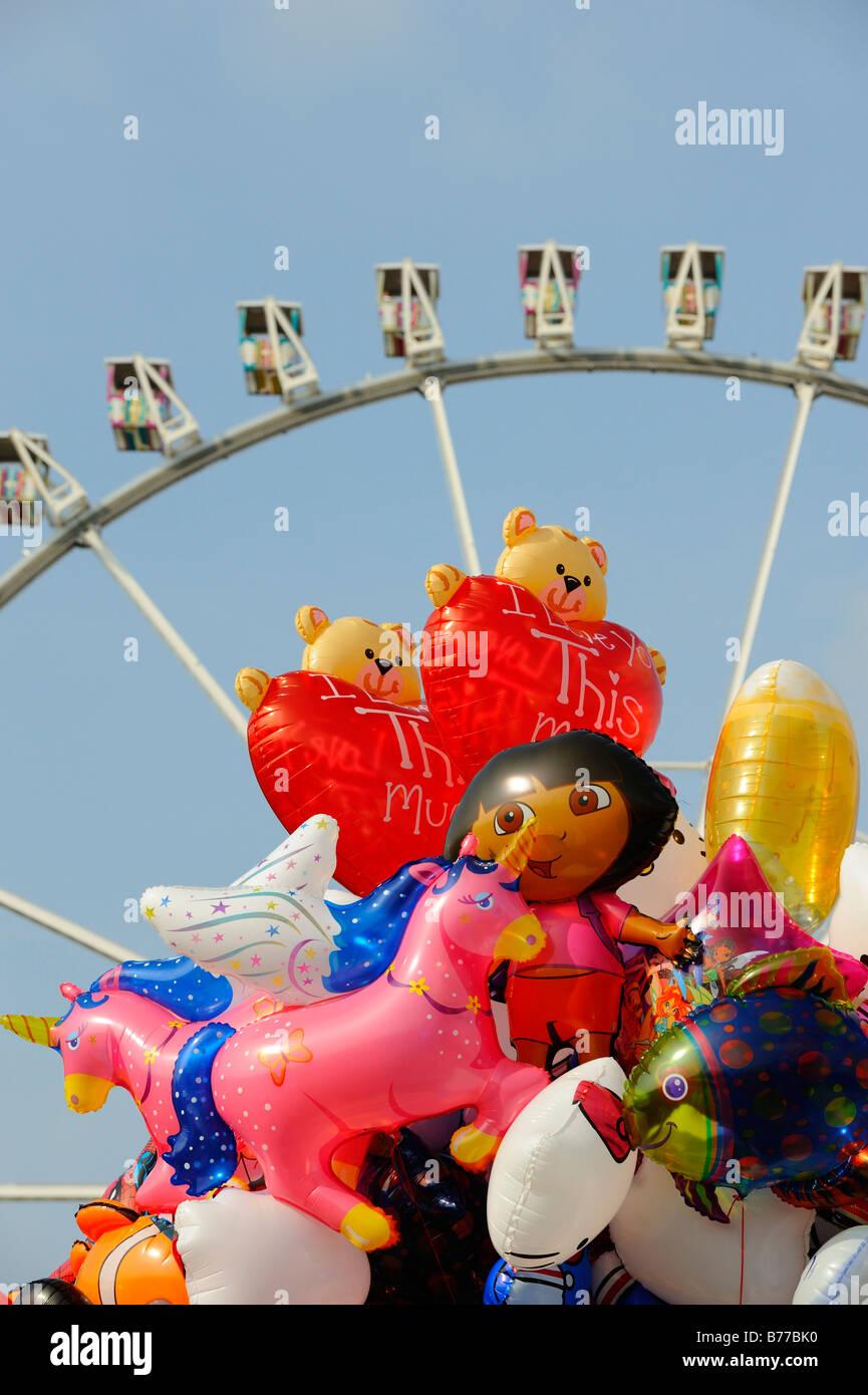 Balloons and ferris wheel Stock Photo