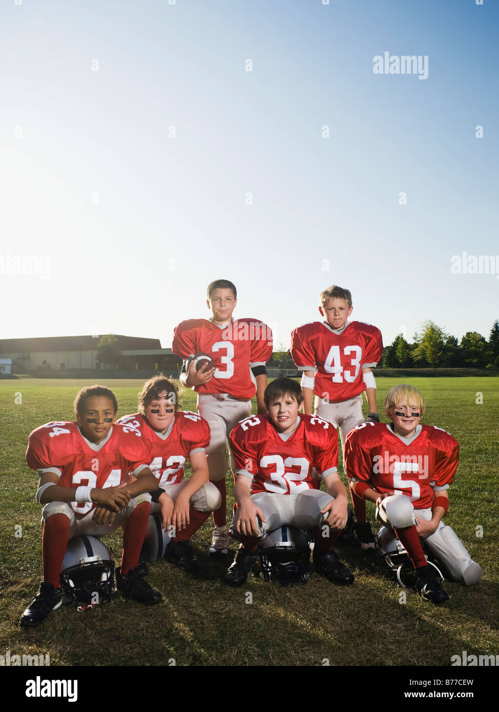 Portrait of youth football team on field - Stock Image