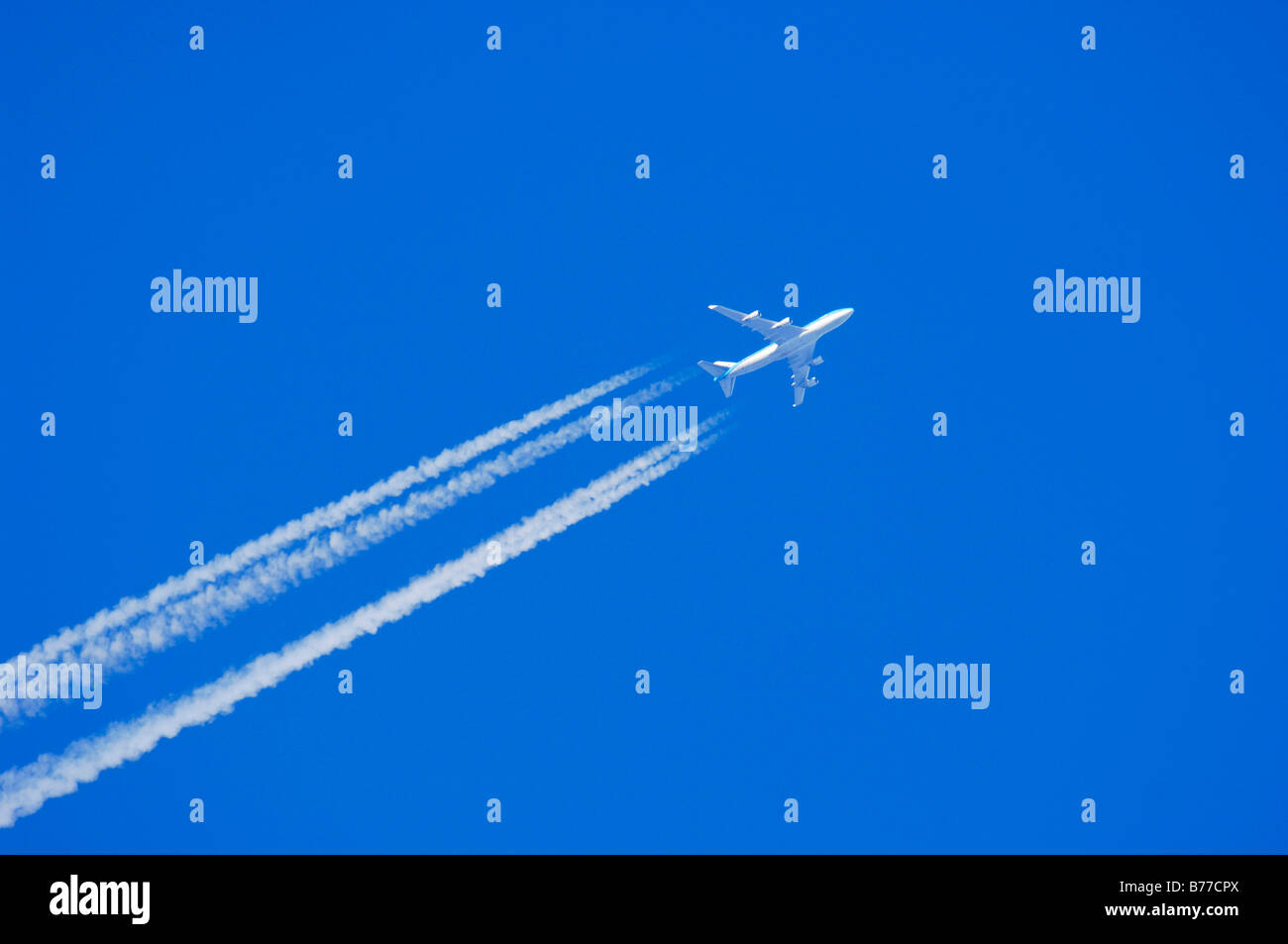 Aeroplane with condensation trail - Stock Image