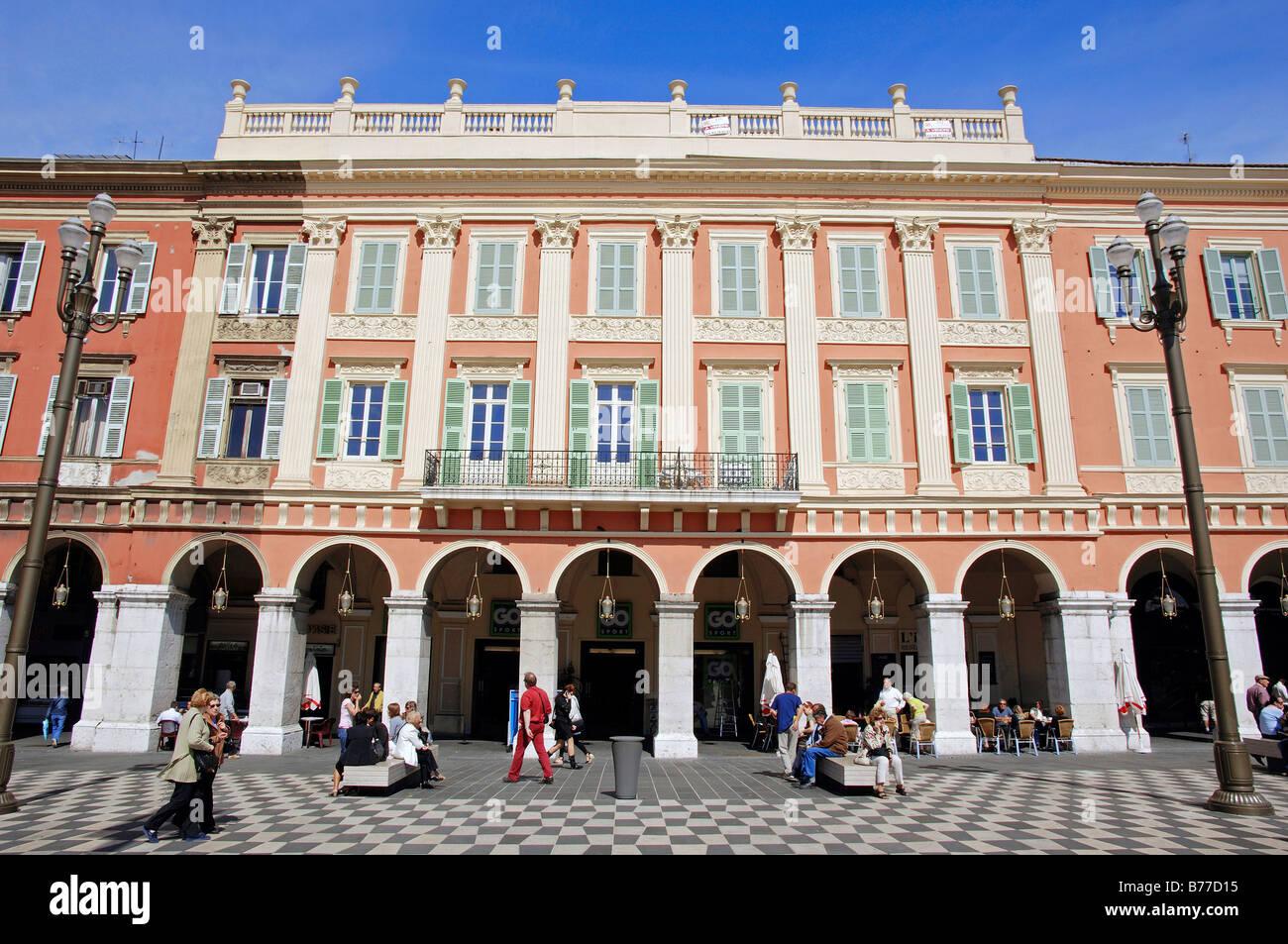 Building with shops and restaurants, arcades, Place Massena, Nice, Alpes-Maritimes, Provence-Alpes-Cote d'Azur, - Stock Image